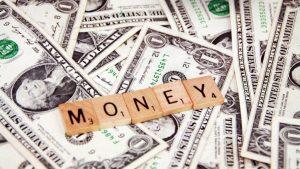 Money-scrabble-tiles-on-dollars