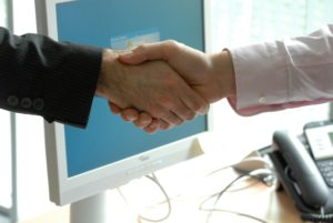 businessmen-shaking-hands-deal